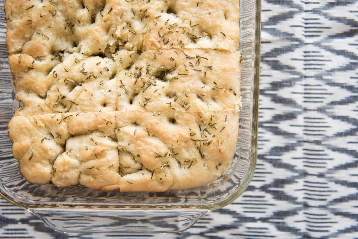 This Easy Rosemary Focaccia Bread recipe is so simple to make and ready in under an hour, so you can have fresh, warm bread with dinner tonight!  If you are looking for an easy focaccia bread recipe, this is it.