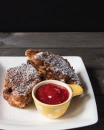 Thesecopycat sweet-meets-savory Disneyland favorite Blue Bayou Monte Cristo Sandwiches are made with rich challah bread stuffed with ham, turkey and cheese, then fried, dusted in powdered sugar, and dipped in jam! Perfect for brunch or dinner!