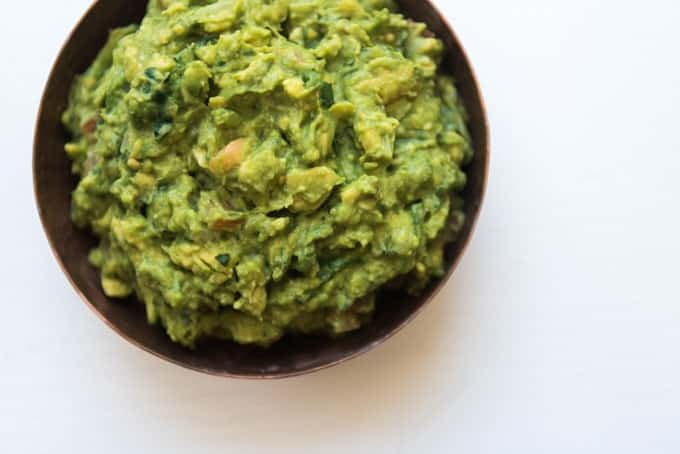 This chunky guacamole is easy, authentic, fresh, and unbelievably, out-of-this-world, amazingly good with lime, garlic, onion & cilantro mixed in with wonderful avocados. It's the best guacamole ever. For real.