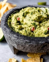 This chunky, homemade guacamole recipe is easy, authentic, fresh, and unbelievably, out-of-this-world good with lime, garlic, onion & cilantro mixed in with wonderful avocados.  This is the best guacamole recipe ever.  For real.