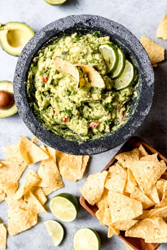 An image of a simple guacamole recipe with chips in a bowl.