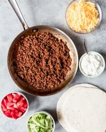 An image of taco meat made with homemade taco seasoning and fixing for ground beef tacos.