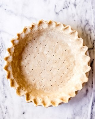 An image of an unbaked pie crust.