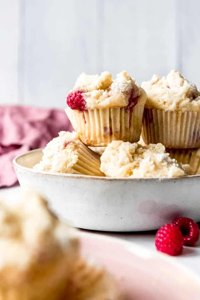 An image of easy raspberry muffins with streusel topping.