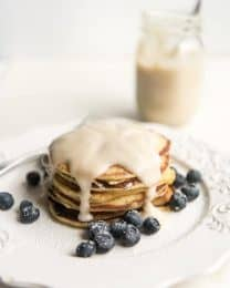 Lemon Ricotta Pancakes with Coconut Syrup are the brightest, sweetest way to start your day! They are light and slightly citrusy and pair perfectly with the homemade coconut syrup recipe also included in this post!