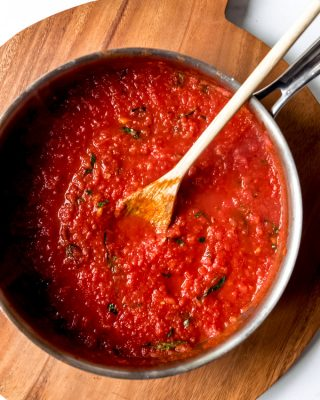 An image of a pot of homemade tomato basil marinara sauce.