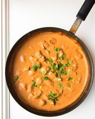 A large skillet of chicken tikka masala.