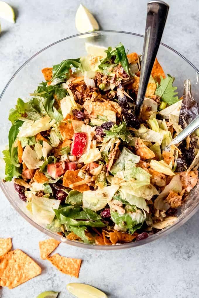 An image of a taco salad tossed with Thousand Island dressing and Nacho Cheese Doritos.