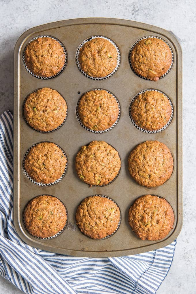An image of twelve morning glory muffins in a muffin pan.