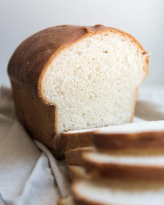 a view of the crumb on an amish white bread after it's been sliced