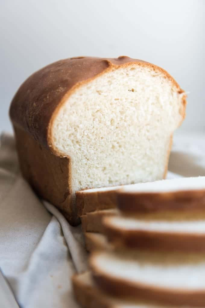 A slightly sweet, soft & tender loaf of Amish White Bread is so simple and easy to make that it is almost easier than picking up a loaf at the store.  And it tastes so much better and fresher!  Perfect for sandwiches, toast, or just eaten piping hot from the oven slathered with butter and honey or jam!