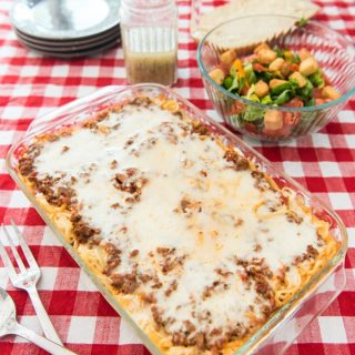 This cheesy baked spaghetti casserole is kid-friendly, filling, and perfect for feeding a crowd. Melty cheese, meaty sauce, and al dente pasta make this a great weeknight meal!