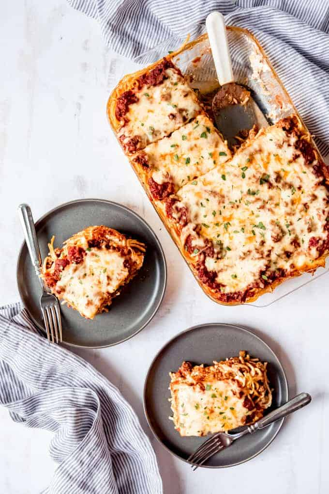 An image of a sliced baked spaghetti served on plates.
