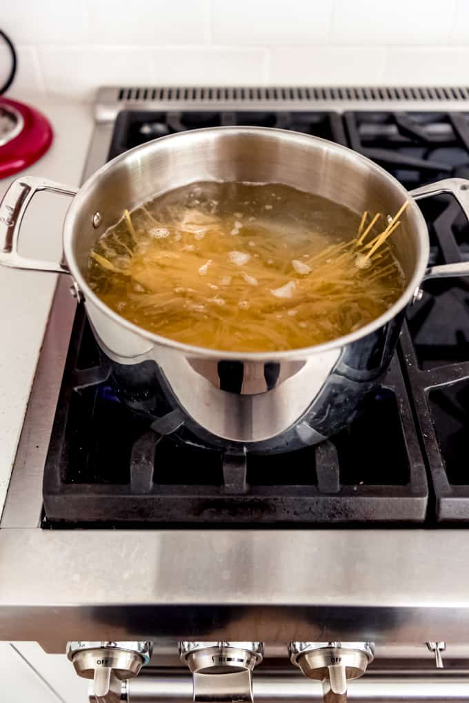 An image of spaghetti noodles in a pot of boiling water.