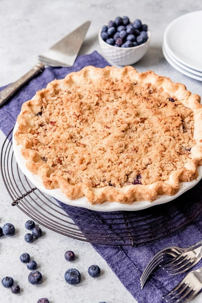 An image of a blueberry pie with streusel topping.