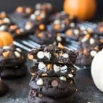 Dark Chocolate Halloween Chip Cookies have a super soft and black-as-night dark chocolate cookie base that is studded with sweet white chocolate chips and creamy peanut butter chips for a frighteningly delicious treat! These are such easy Halloween cookies to make!
