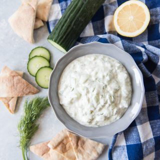 Greek Tzatziki Sauce is a bright, delicious combination of Greek yogurt, cucumber, garlic, and a few other traditional flavors that are incredible with meat, fish, veggies, or bread. It is so easy and takes all of 5 minutes to make your own batch that is vastly superior to anything you can pick up at the market!