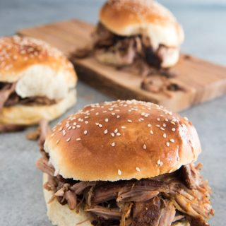 This succulent, sweet & spicy slow cooker pulled pork is cooked low and slow and then pulled into tender, juicy shreds and served up barbeque style on a buttery brioche bun.