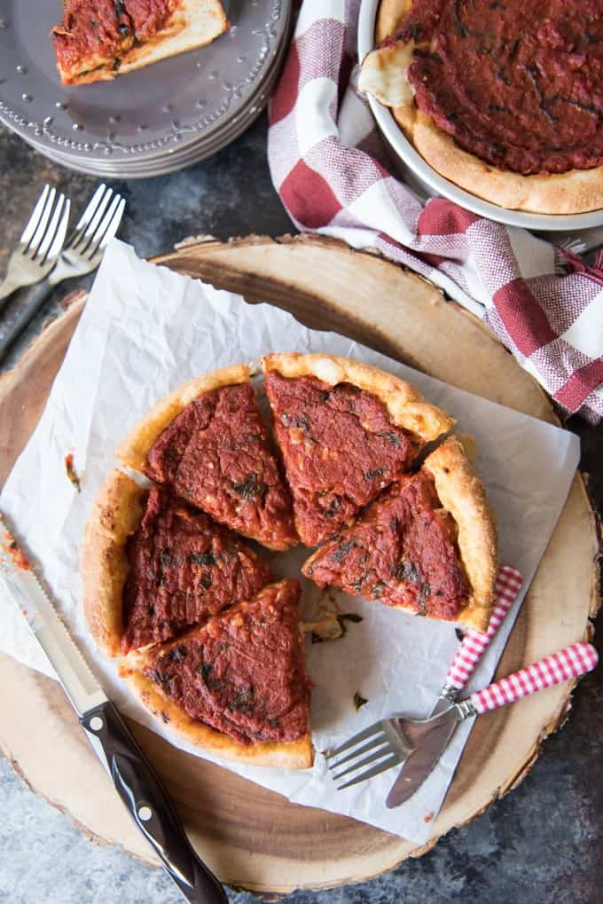 Chicago Deep Dish Pizza has a buttery, flaky crust and a thick layer of gooey, melted mozzarella cheese with a satisfyingly rich, tomato basil sauce. You're gonna' need a fork, not just your hands for this pizza!