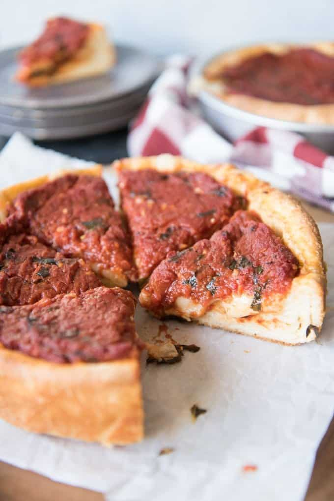 An image of a sliced Chicago deep dish pizza.