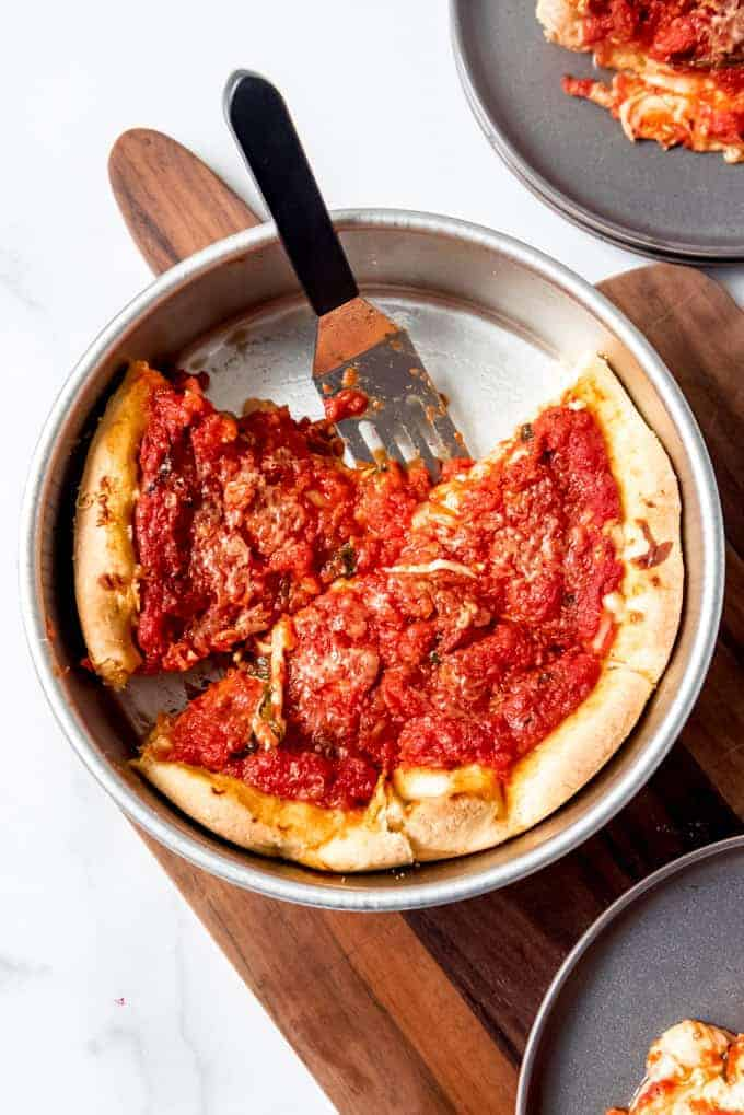 An image of a Chicago deep dish pizza in a 9-inch pan.