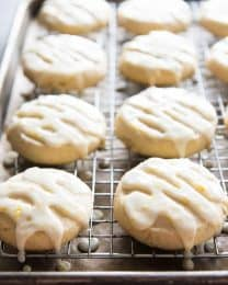 double lemon glazed cookies on a wire cooling rack