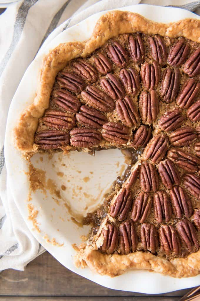 a close view of a pecan pie missing a slice