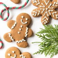 Gingerbread Men Cookies next to a string of yarn and greenery