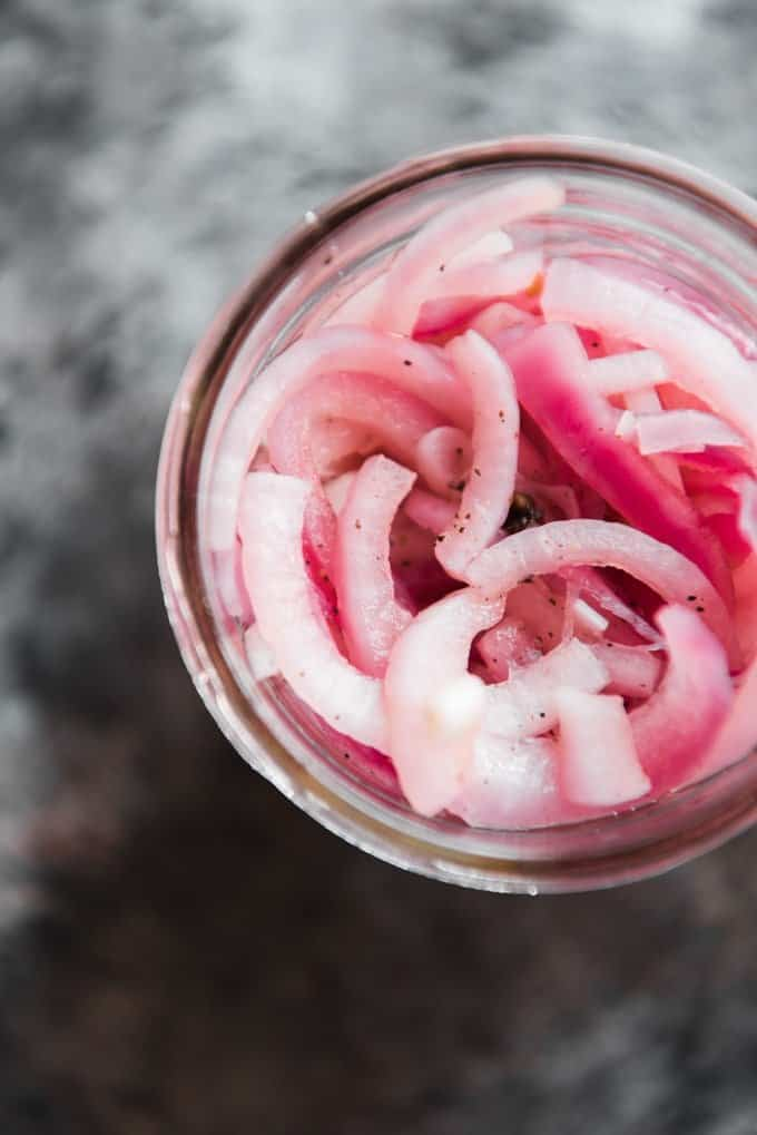 an aerial view of a jar full of sliced red onions