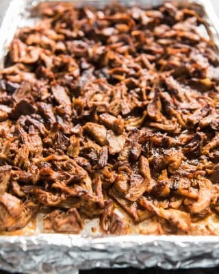 a foil lined baking sheet with shredded pork on it