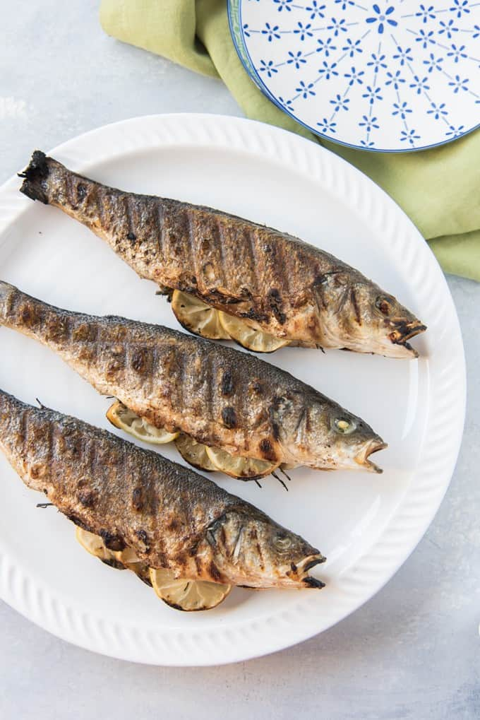 Branzini, Arctic Char, Red Snapper and Sea Bass all turn out amazing with this simple, rustic approach to grilled whole fish that is a healthy, wonderful dinner option for family or guests!