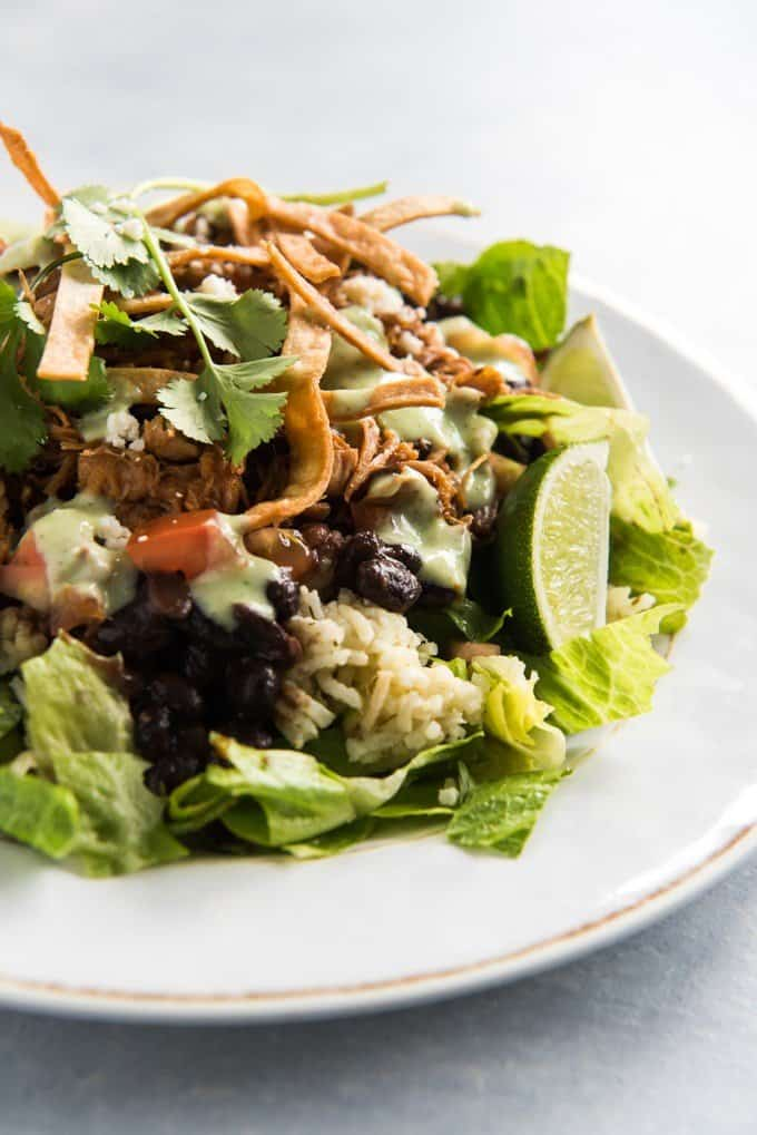 a side view of a cafe rio pork salad on a white plate