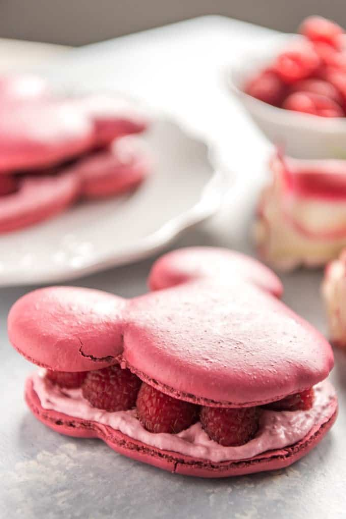 mickey mouse shaped raspberry rose macarons with fresh raspberries inside