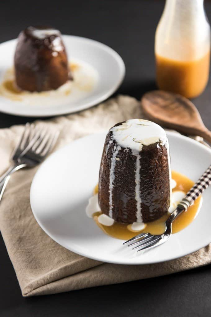 Sticky Toffee Pudding Cake is a deliciously moist, date cake drenched in a warm butterscotch-toffee sauce.  It's a classic and iconic British dessert popular in all of England, Scotland and Ireland, and it's easy to see why!