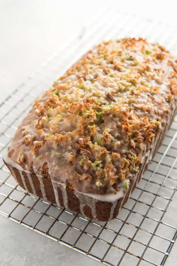 This Coconut Lime Glazed Banana Bread takes a sweet, tropical twist on traditional banana bread. It's a great way to use up overripe bananas, and every bite of the crust is studded with toasted coconut and lime zest from a simple glaze.