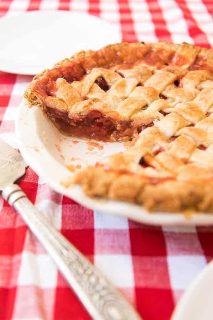Strawberry Rhubarb Pie missing a slice