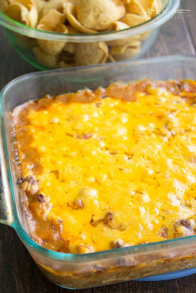 a glass baking dish with chili cheese dog dip inside