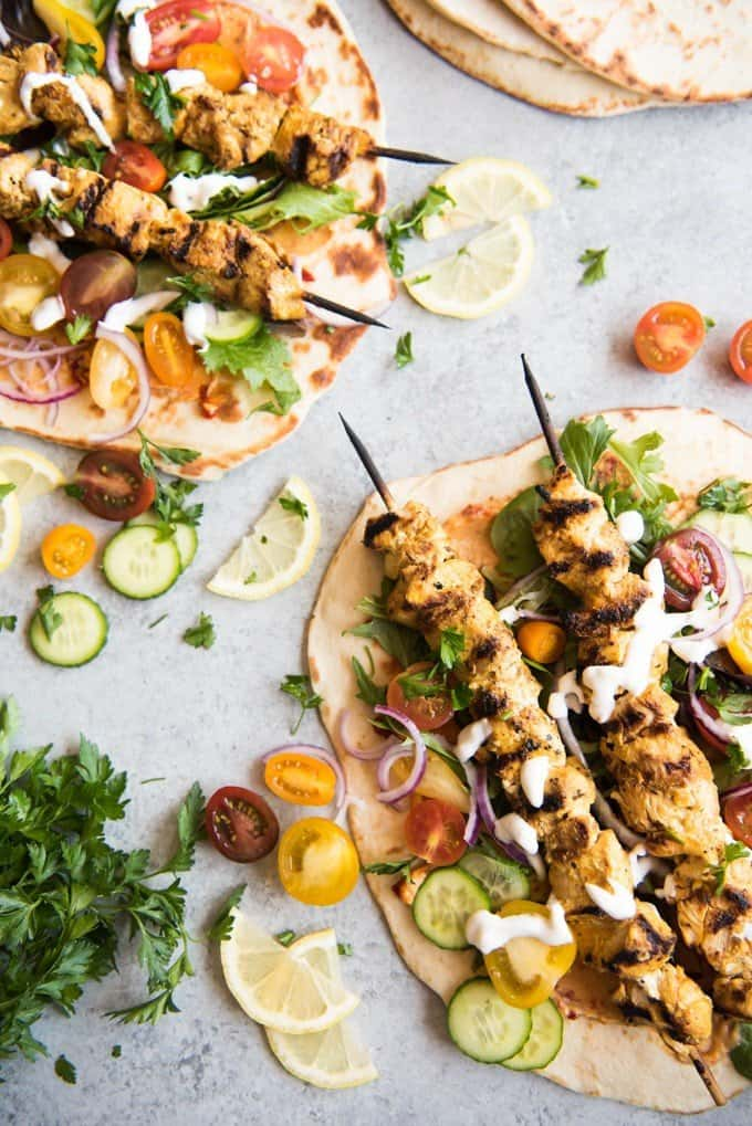 Grilled Chicken Shawarma Wraps are inspired by middle eastern street food where chicken is marinated in spices and then roasted on a spit to perfection and wrapped up in flatbread for a delicious sandwich.  Beats takeout or fast food any day!