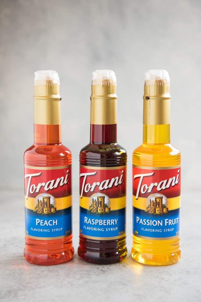 peach raspberry passion fruit torani syrup bottles
