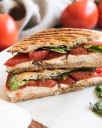 Grilled Caprese Panini takes a simple grilled cheese sandwich and elevates it to a whole other level! Made with summer-ripe, thick-sliced tomatoes, fresh creamy mozzarella, and flavorful fresh basil, all of the elements on a classic caprese salad are present in a delicious, toasted grilled caprese panini!