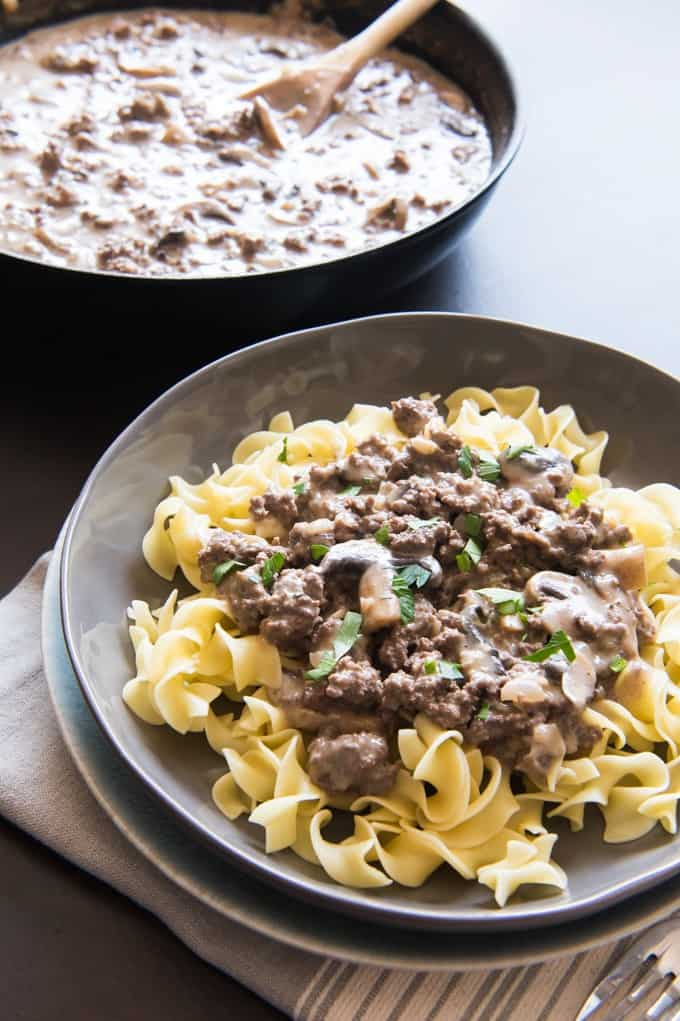 Looking for a great, classic weeknight dinner option that the whole family will love?  This Ground Beef Stroganoff recipe is ready in less than 30 minutes, made from scratch, and is hearty, satisfying and delicious!  It's the best ground beef stroganoff recipe without cream of mushroom soup ever!