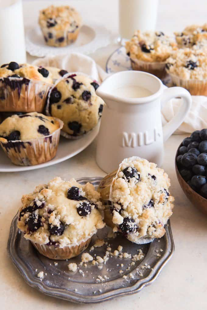Nothing beats Homemade Blueberry Muffins with Crumb Topping and a large glass of cold milk!  Bursting with fresh blueberry muffin flavor and topped with a sweet crumb topping, these really are the best blueberry muffins ever!  You can make these blueberry muffins with frozen blueberries if fresh ones aren't available or are out of season and crazy expensive.