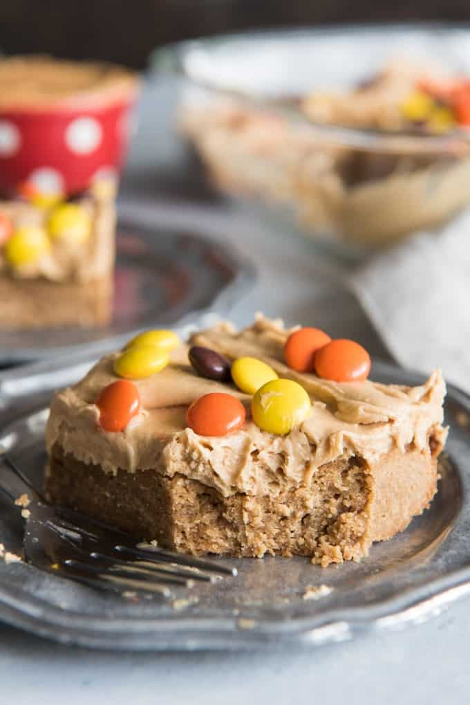 a slice of peanut butter blondie with peanut butter candies on top