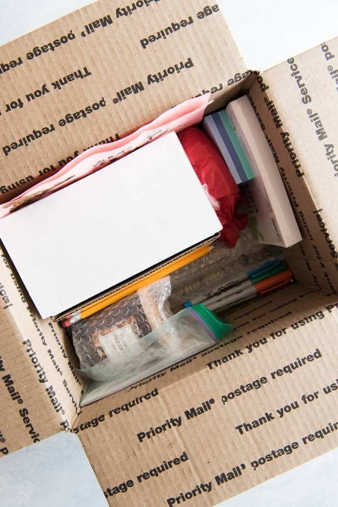 an aerial view of inside of a shipping box full of supplies and stuff