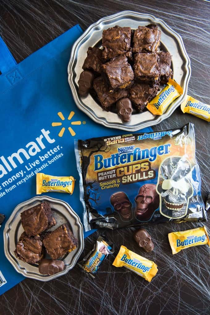 These Butterfinger Brownies are rich and fudgy, with the signature crispety, crunchety, peanut buttery-ness of Butterfingers! Don't wait until you have leftover Halloween candy to make these! Make sure you grab an extra bag of Butterfingers Peanut Butter Skull Cups to have on hand just for baking these frightfully delicious Halloween brownies!