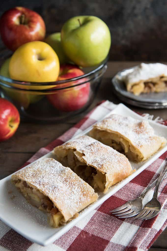 This Apfelstrudel recipe (German Apple Strudel recipe) might sound daunting, but it's much easier than it seems and so much fun to make.  And the resulting apple strudel is a delicious, festive-feeling dessert filled with sweet, spiced apples and raisins in a flaky crust that everyone will love.