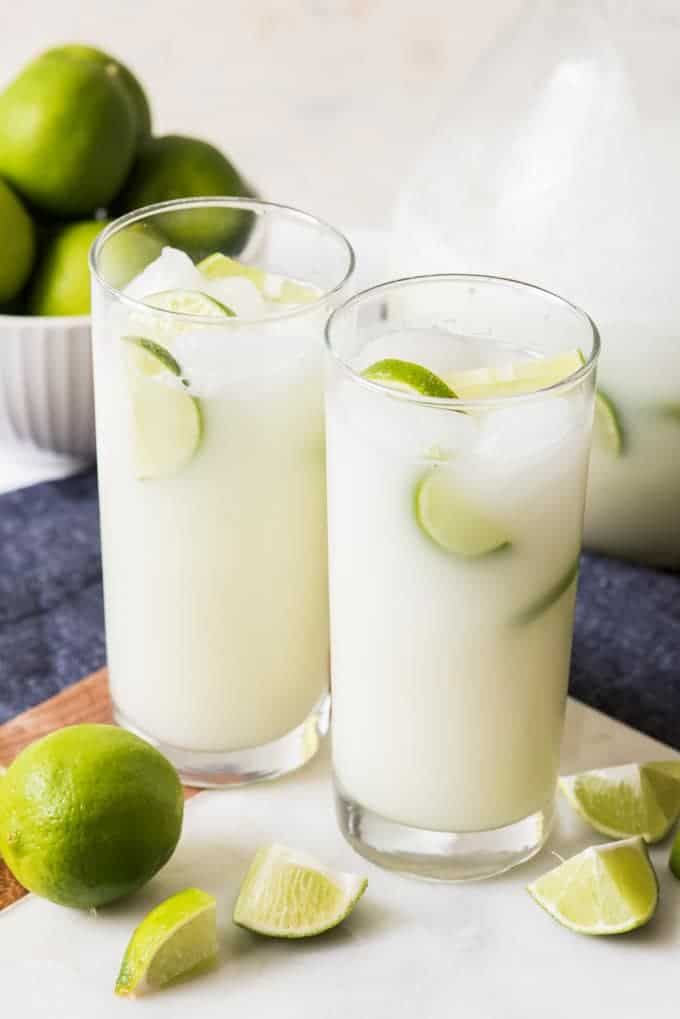 two glass cups full of brazilian limeade