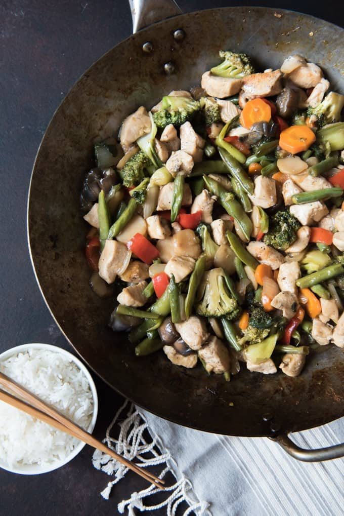 This Easy Chicken & Vegetable Stir-Fry is one of our go-to meals when it comes to easy weeknight dinners.  Lots of tender crisp veggies and chunks of seared chicken are combined in a classic stir-fry sauce for an excellent, healthy dish your whole family will enjoy!