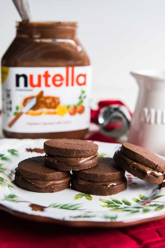 Two slice-and-bake homemade chocolate cookies sandwiched around a rich, delicious nutella filling make these Double Chocolate Nutella Sandwich Cookies as much fun to make as they are to eat!  Perfect with a glass of milk!