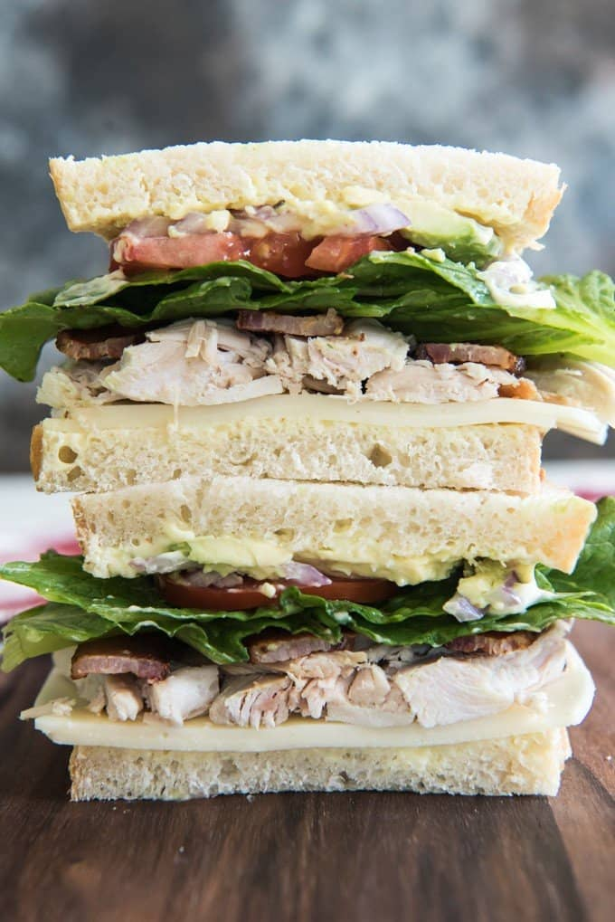 This Turkey Bacon Avocado Sandwich is inspired by my favorite bakery & cafe in Utah.  Kneaders makes the most amazing food, and this sandwich is my go-to item on their menu, especially with their mustard-mayo that gets slathered on the bread!